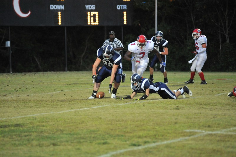 Number 7, Vincent Campbell pursues Pleasant View Christian in a broken play